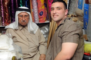 Dustin and Mohammad Saleh Nishwar at Souq Waqif in Doha, Qatar, March 8, 2010. Nishwar has sold merchandise at Souq Waqif for more than 60 years. The shop, packed with fabrics, clothes and prayer rugs, hasn't budged in almost 100 years.